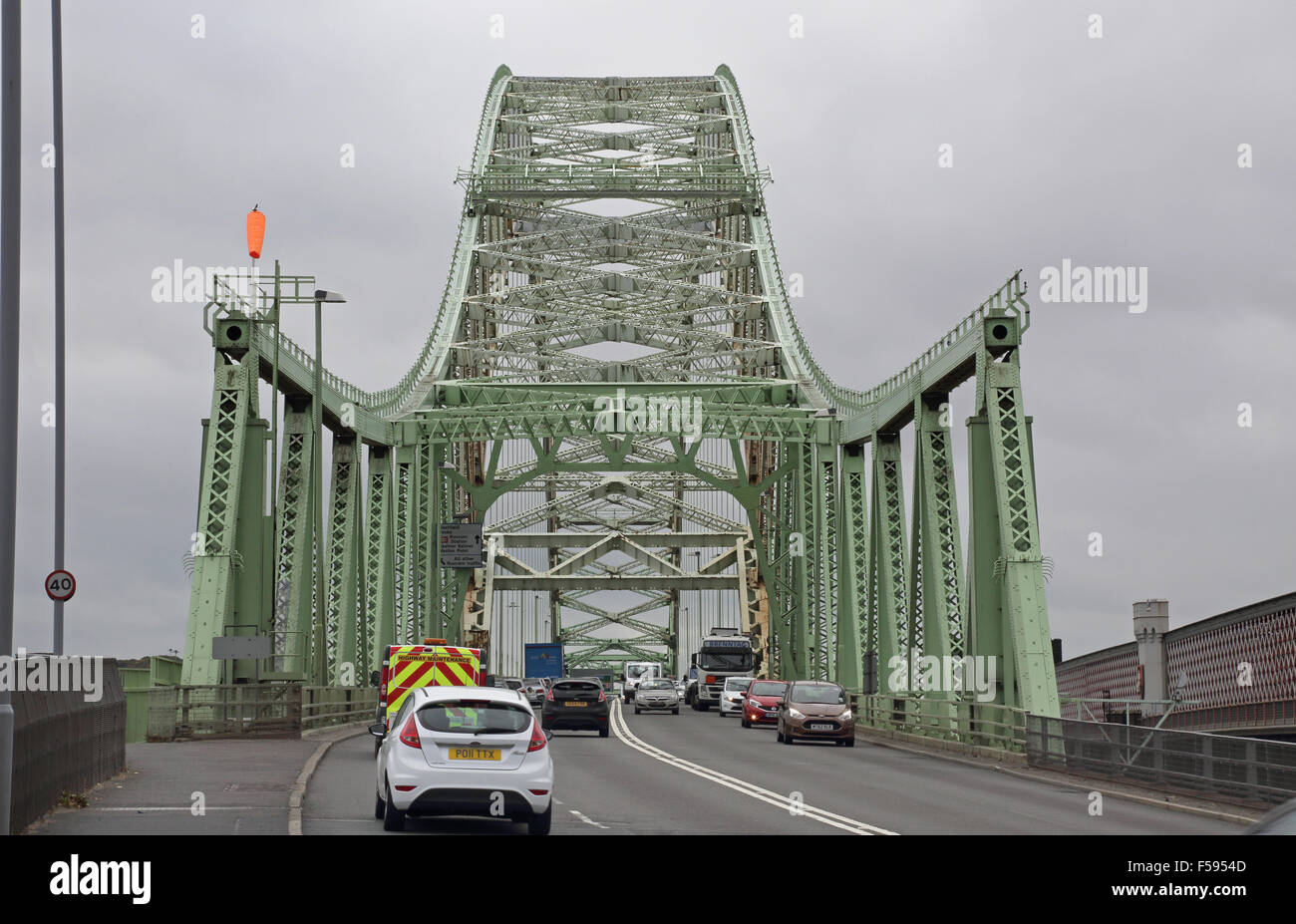 Traffic crossing the Silver Jubilee bridge over the River Mersey in Runcorn, UK. Bridge viewed from the north. - Stock Image