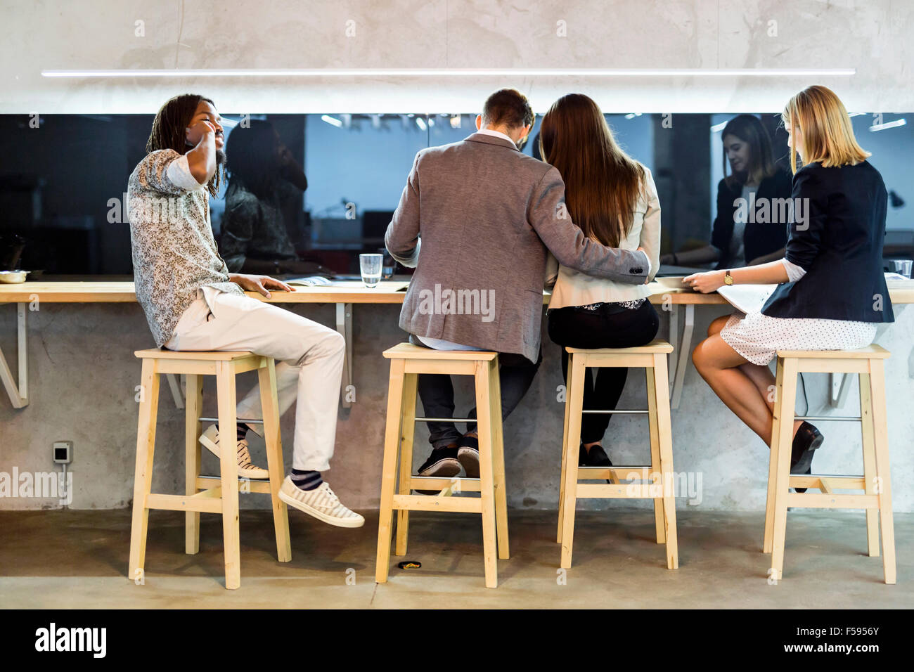Group of people having a break from work in the cafeteria - Stock Image
