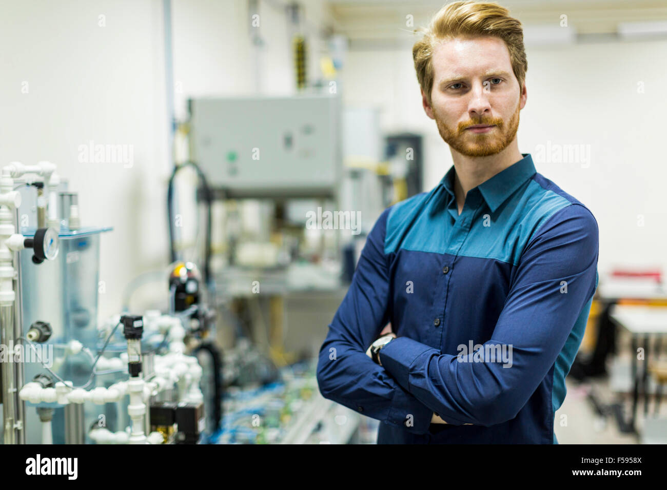 Young smart student portrait in a laboratory - Stock Image