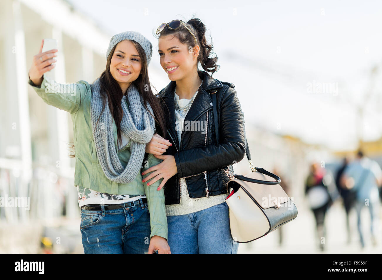 Two young women taking a selfie of themselves - Stock Image