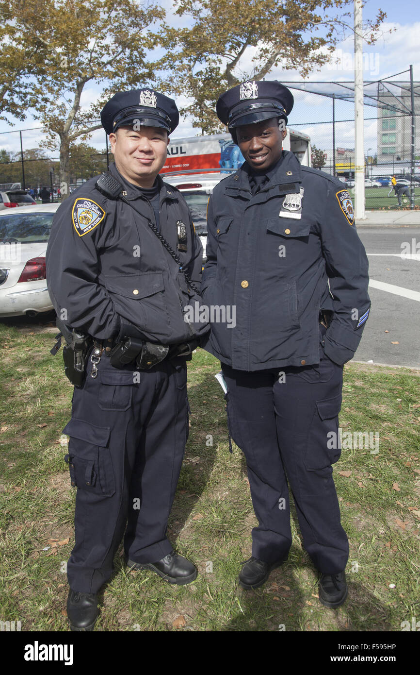 Chinese and African American NYPD police officers pose  at the Chinese Autumn Festival and Lantern Parade in the - Stock Image