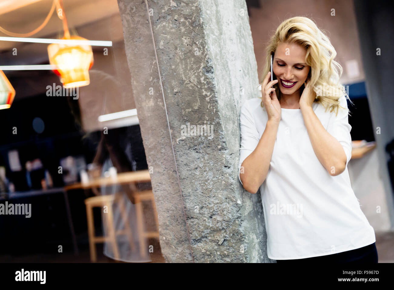 Beautiful woman talking on mobile phone - Stock Image
