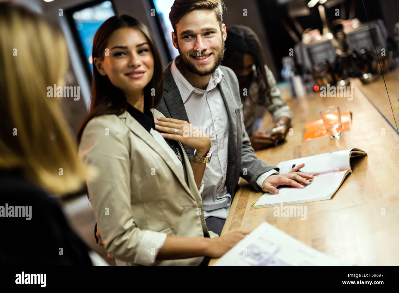 Business people in a pub relaxing and having fun Stock Photo