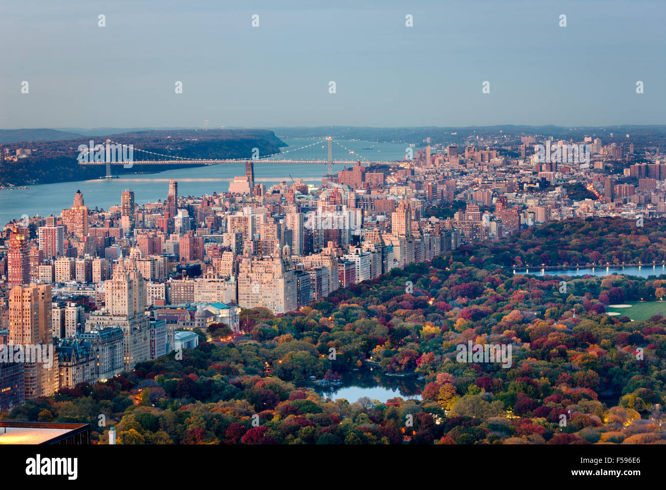 Aerial sunset view of Upper West Side of Manhattan and Central Park in Fall with George Washington Bridge and Hudson - Stock Image