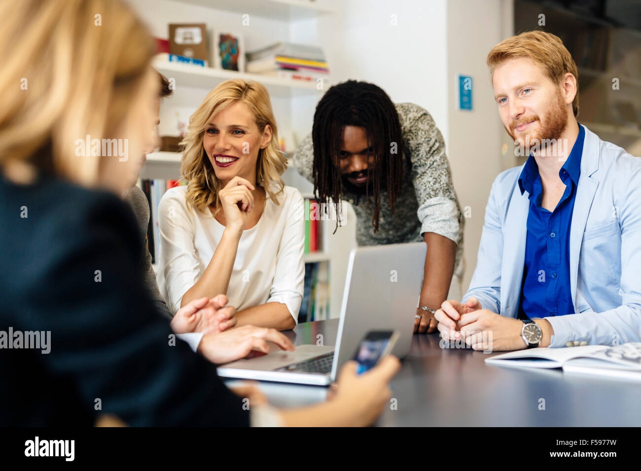 Team of skilled designers and business people working together on a project - Stock Image