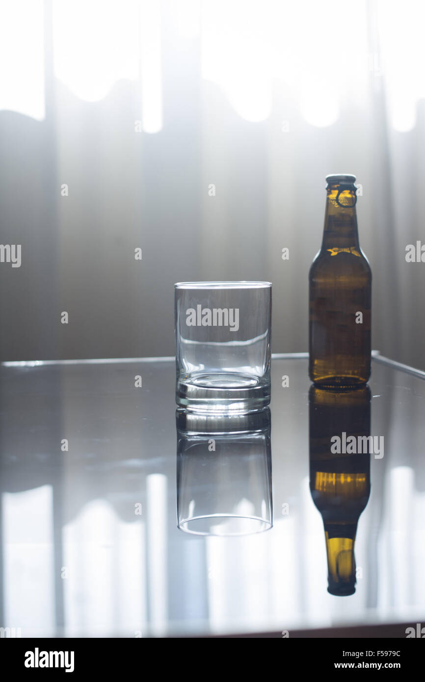 Brilliant Bottle Of Beer And Empty Glass On Glass Coffee Table In Room Alphanode Cool Chair Designs And Ideas Alphanodeonline