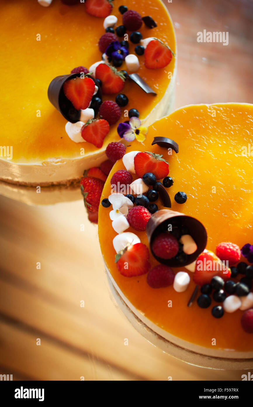Wedding cheese cake with fresh berries and chocolate - Stock Image