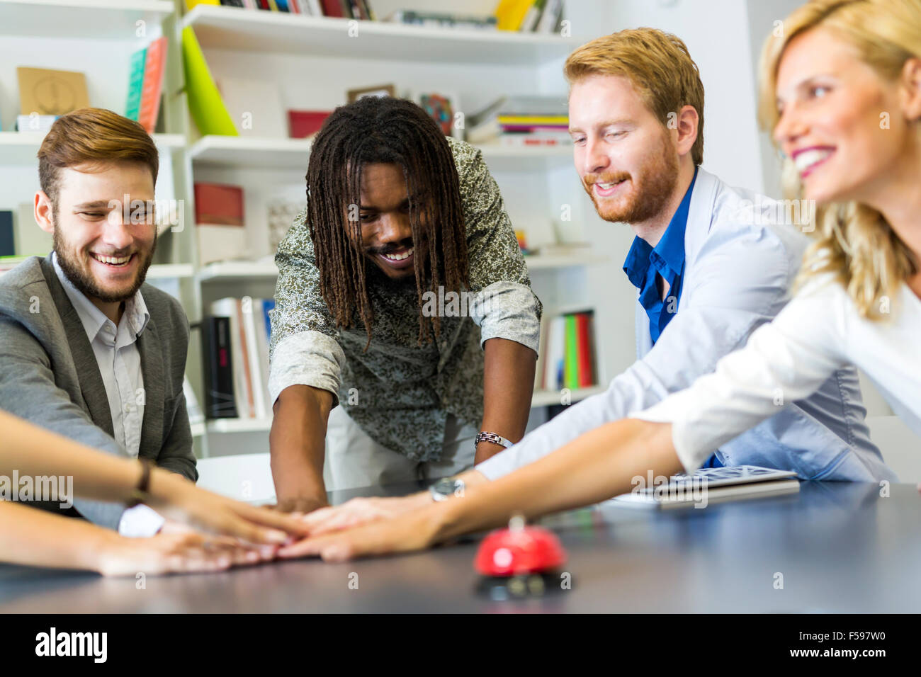 United as one to achieve comapny goals -  each colleague putting effort into the project - Stock Image