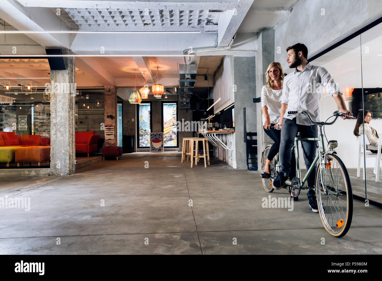 Business people on twin bicycle with mutal goals and same vision in business - Stock Image