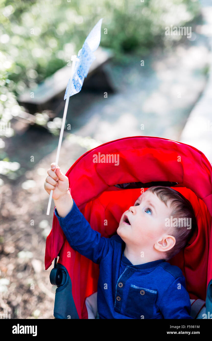 Beautiful little boy with his windmill - Stock Image
