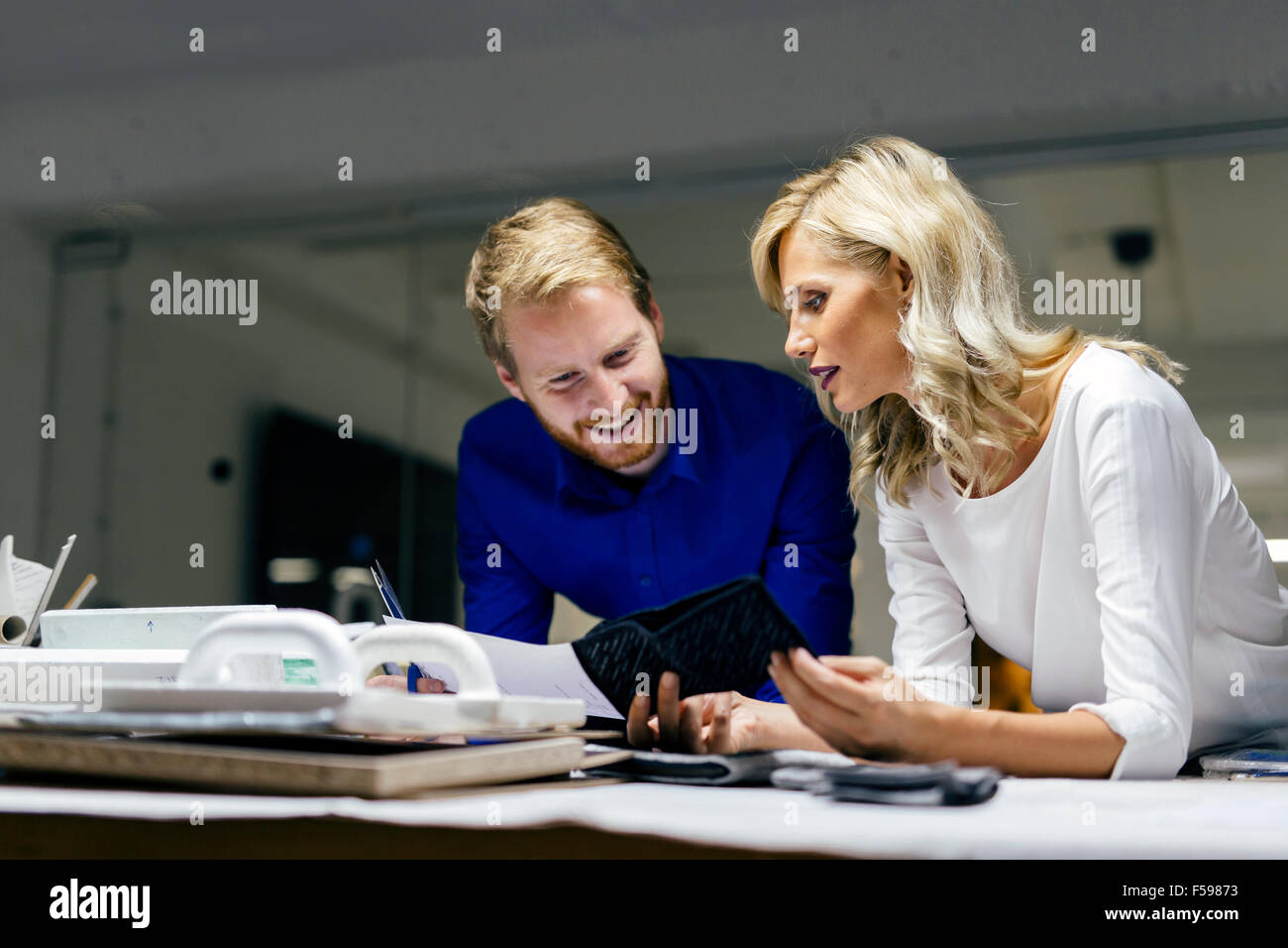 People working in fashion industry and designing clothes - Stock Image
