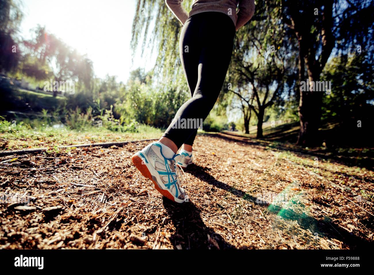 Closeup of runner feet jogging in nature - Stock Image