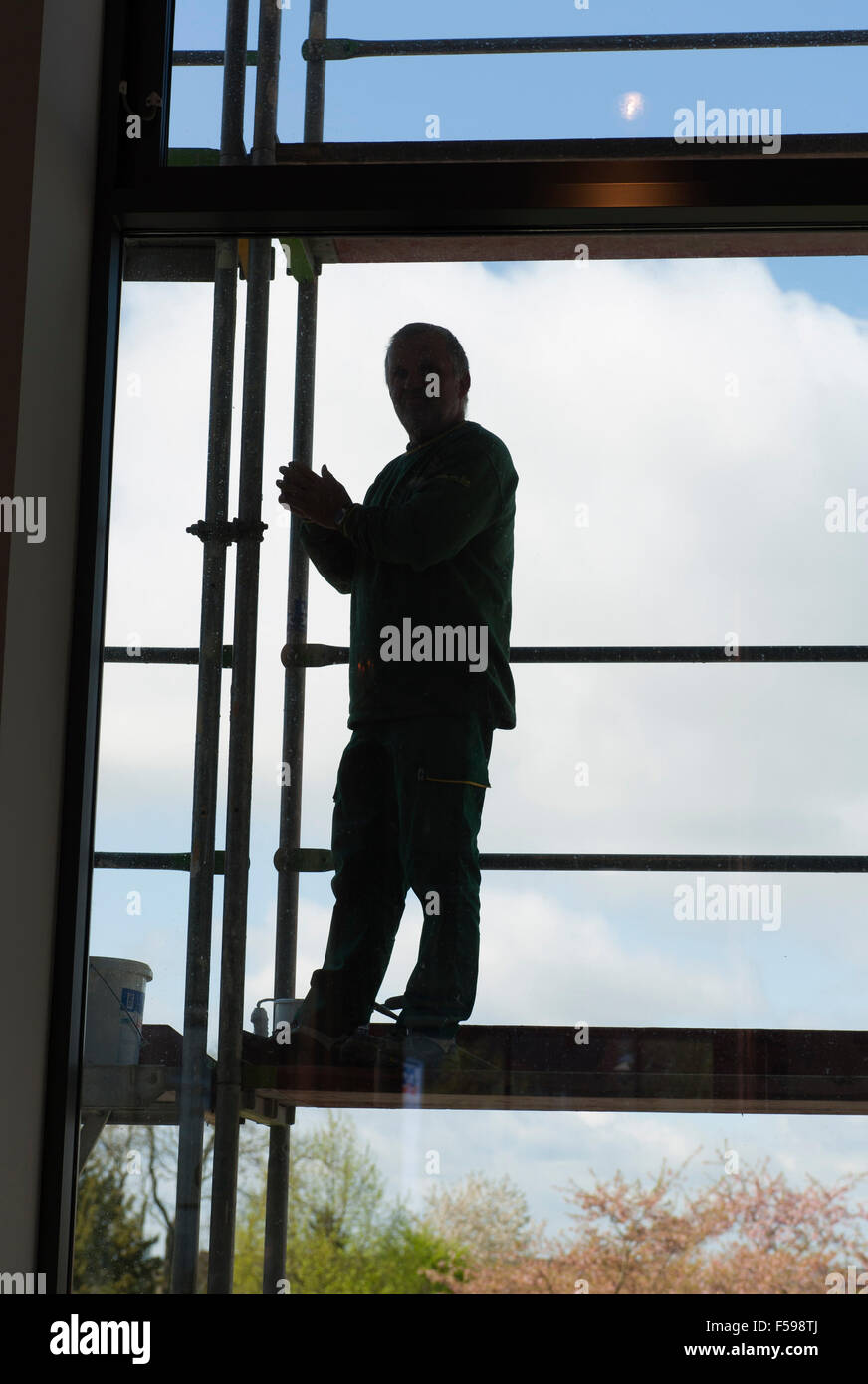 Worker on scaffolding - Stock Image