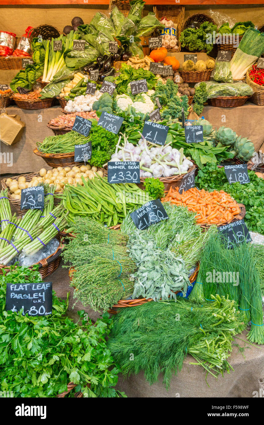 Fresh vegetables and herbs on sale on a market stall at Borough market borough high street London England UK GB - Stock Image