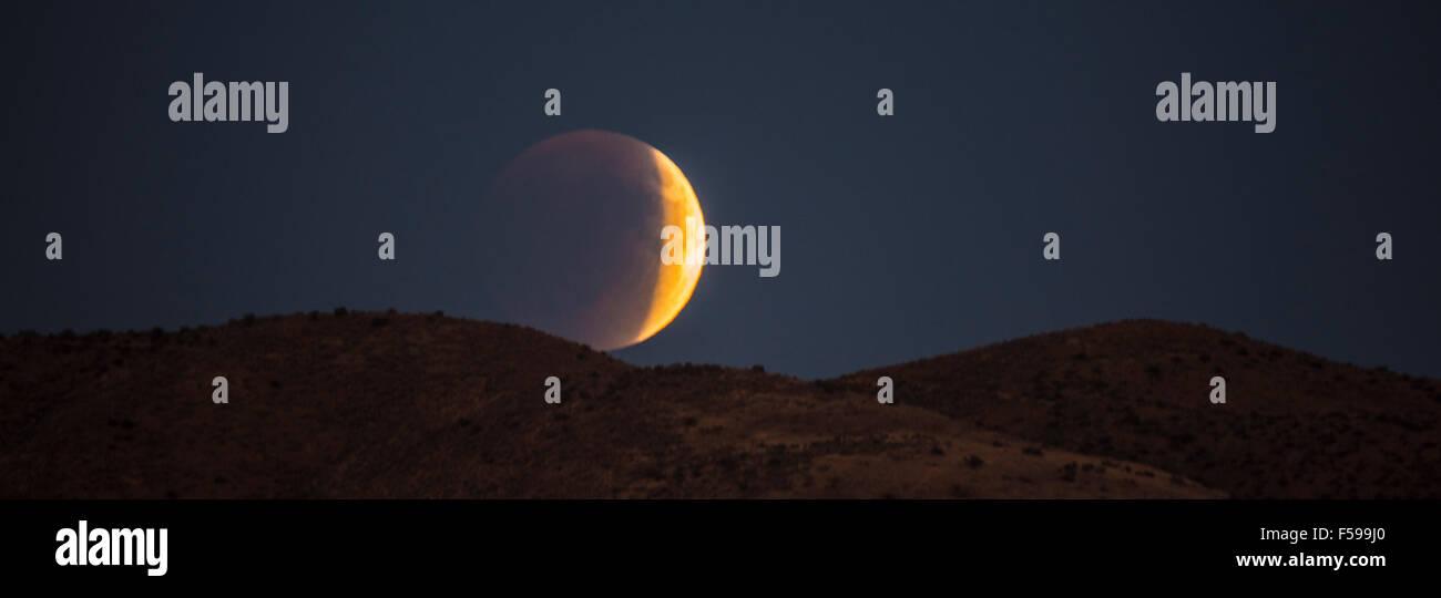 Rare Red Full Moon Lunar Eclipse rising over mountains, Boise, Idaho, USA Stock Photo