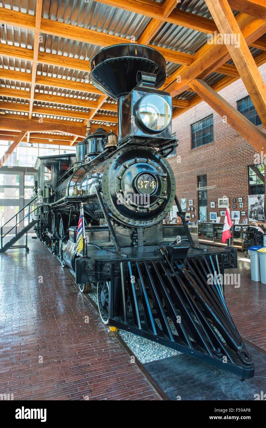 Canadian Pacific steam engine No. 374 (1886),the first transcontinental train to Vancouver. Roundhouse Mews, Vancouver, - Stock Image