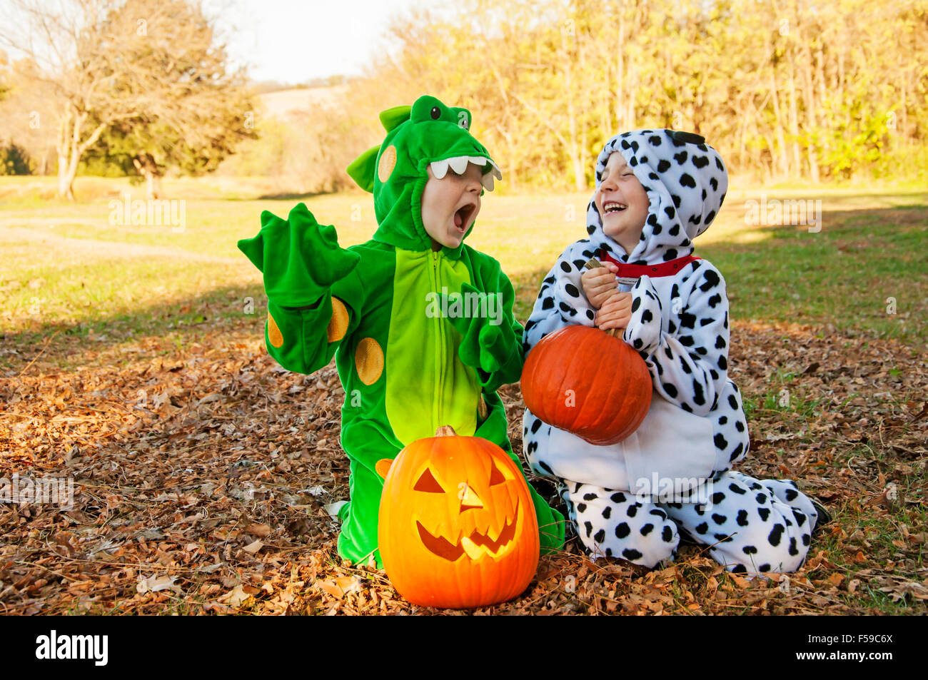 Boys in costumes playing pretend - Stock Image
