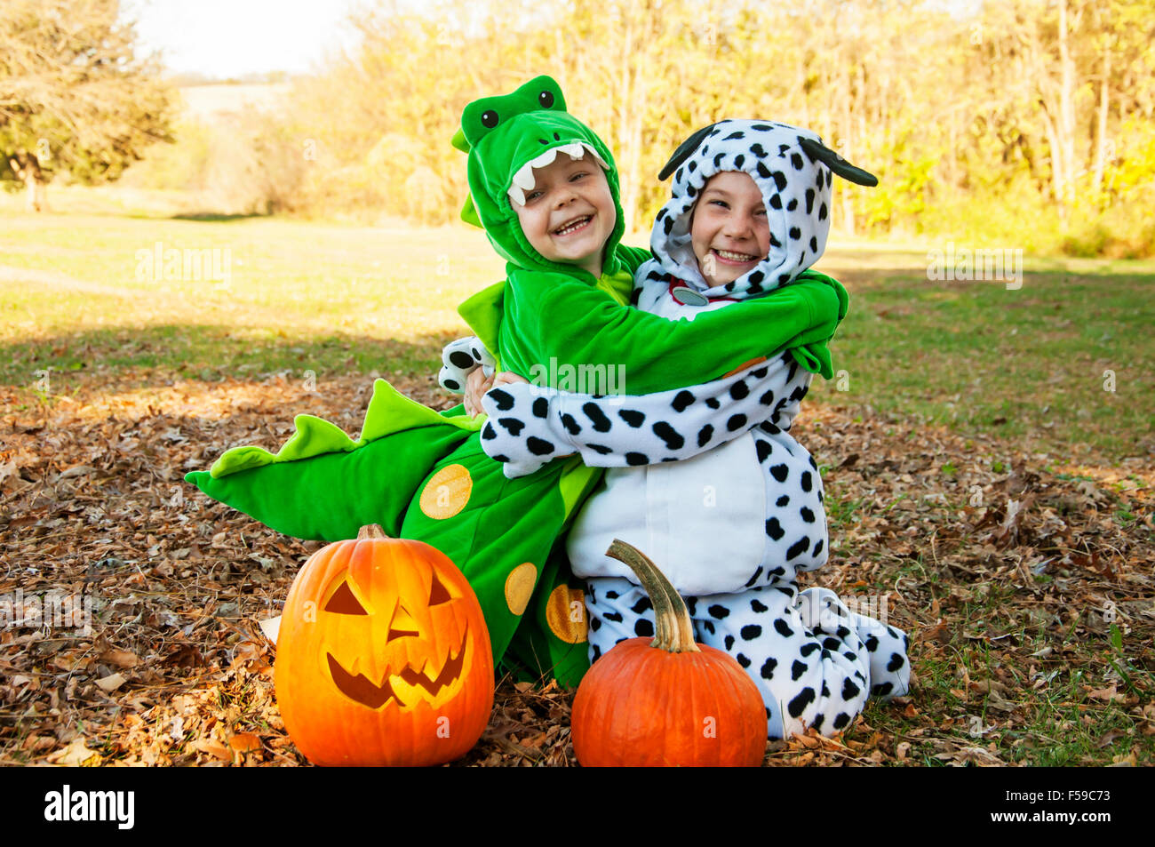Two kids in costume hugging - Stock Image