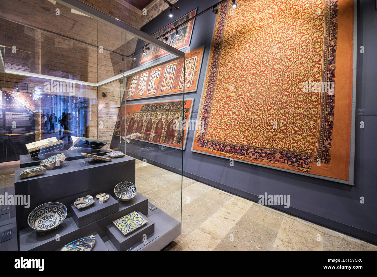 Rugs and ceramics in the Museum of Turkish and Islamic Arts, Hippodrome, Sultanahmet, Istanbul, Turkey. - Stock Image