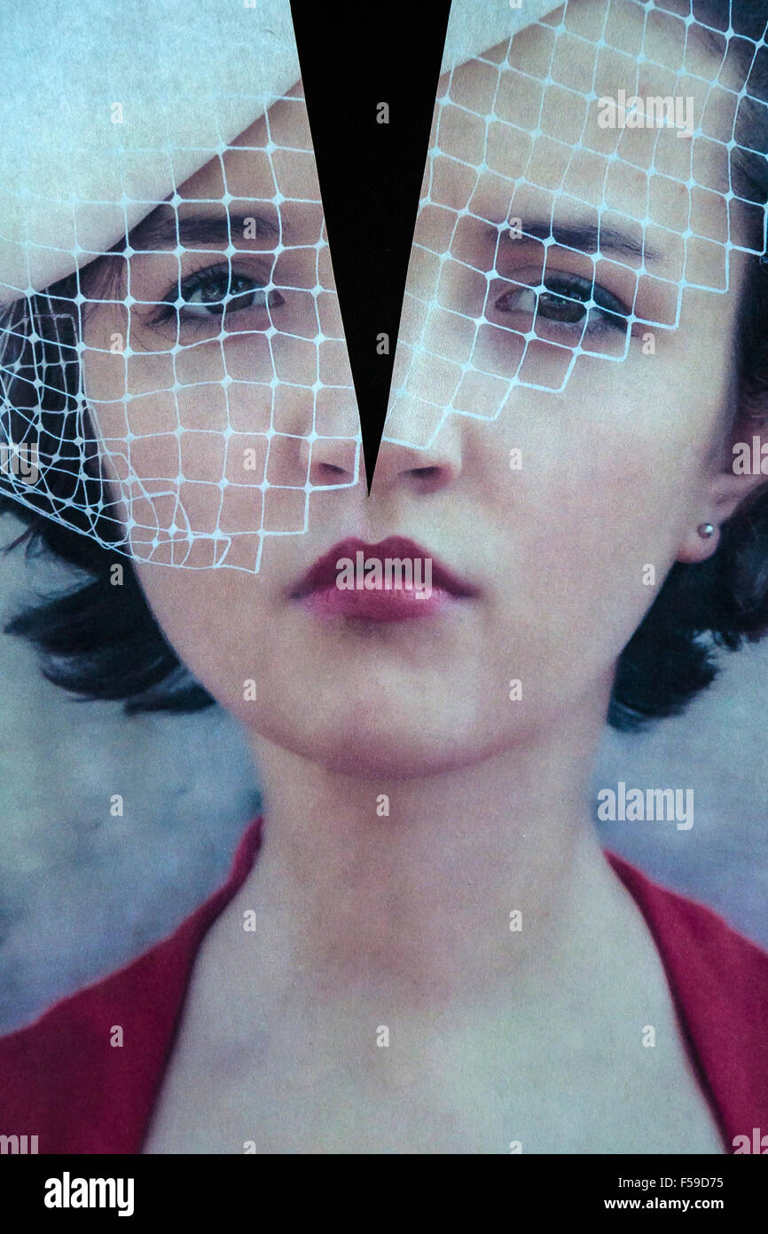 a torn photo of a woman - Stock Image