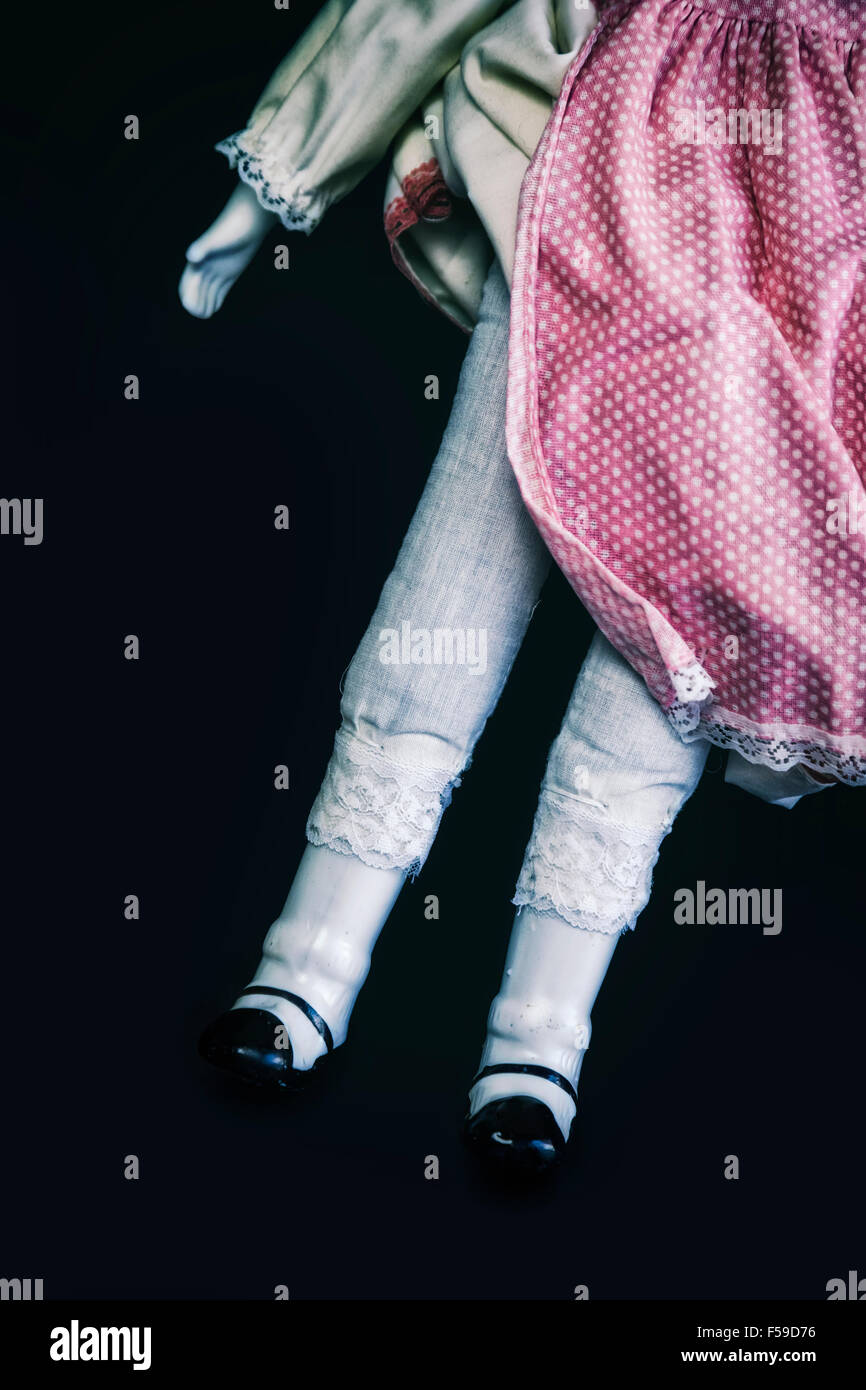 legs of a vintage doll - Stock Image