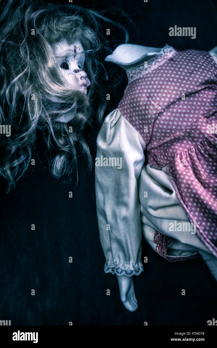 detached head of a broken doll - Stock Image