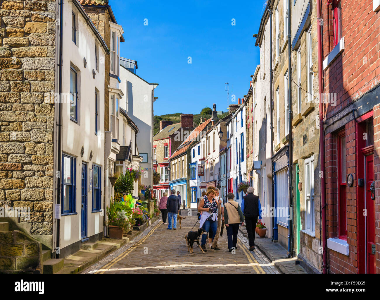 The High Street in the traditional fishing village of Staithes, North York Moors National Park, North Yorkshire, - Stock Image