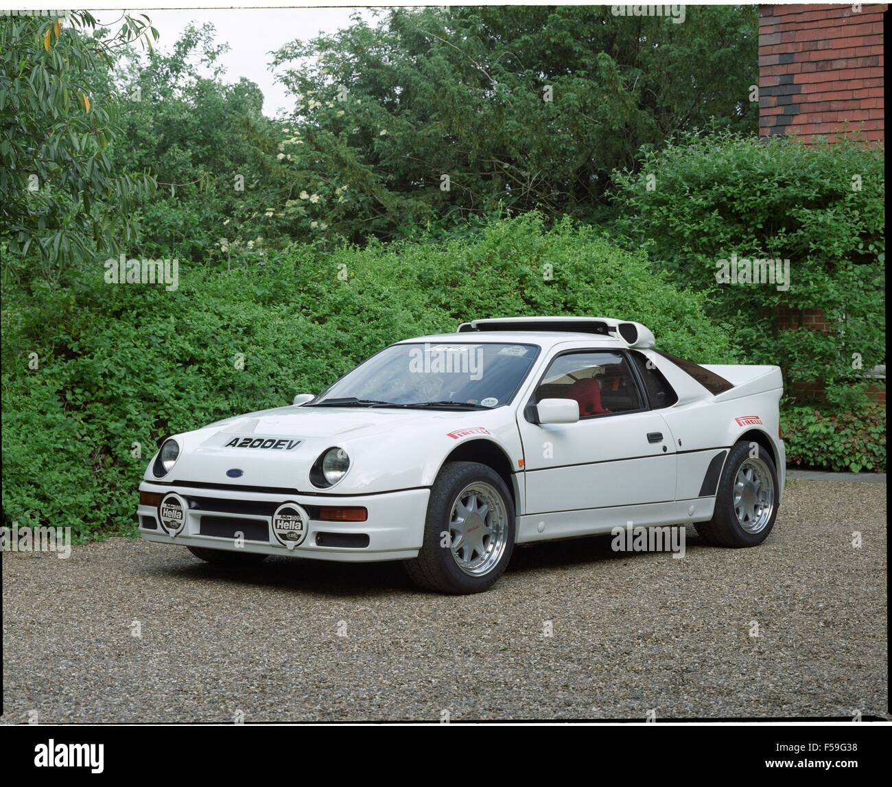 Ford RS200 / RS 200 Road Car In Diamond White   Mid Engined Sports Car  1980s   Showing Car Front And Side On Countryside Setting