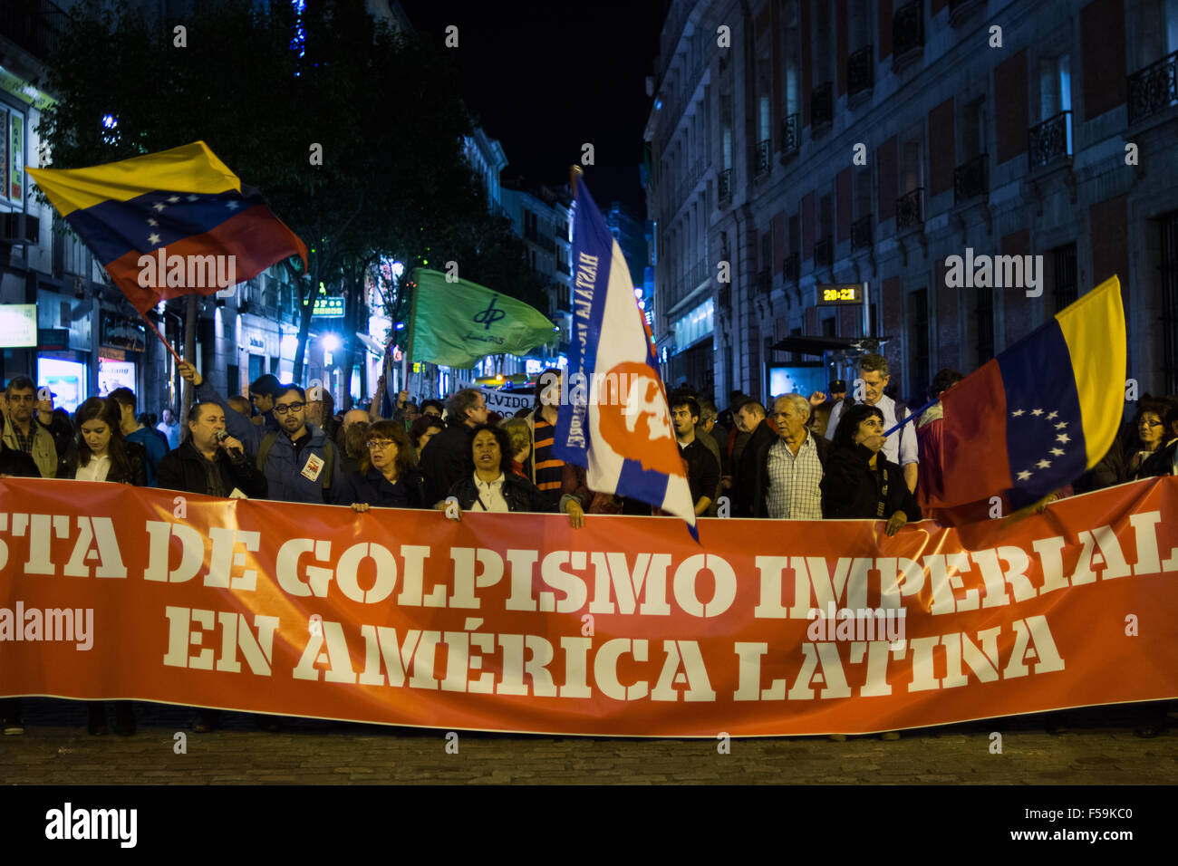 Madrid, Spain. 30th Oct, 2015. Peoplebring banner and flags during a demonstration in Madrid against imperialism - Stock Image