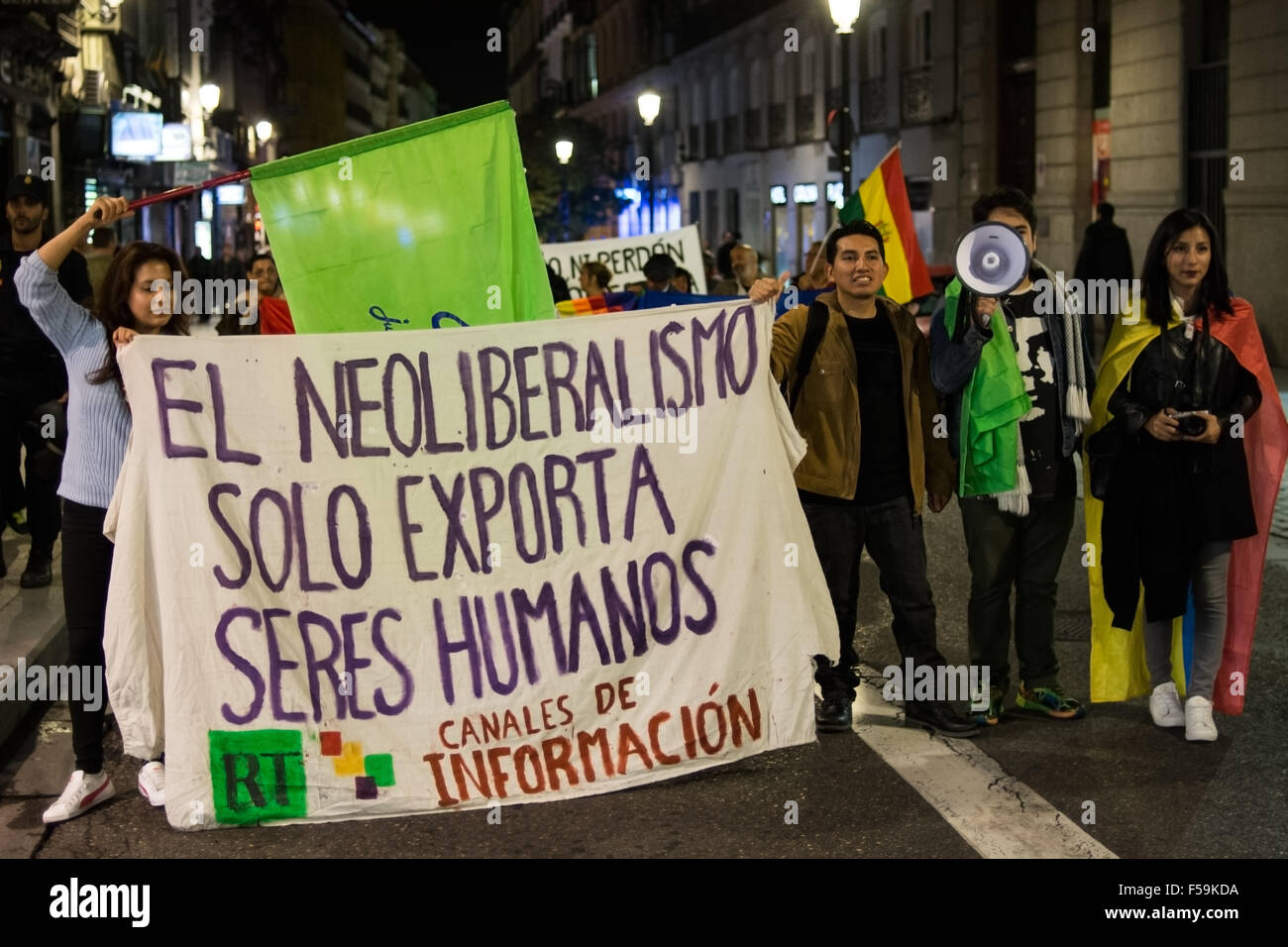 Madrid, Spain. 30th Oct, 2015. People protesting with a banner that reads 'Neoliberalism only exports human - Stock Image