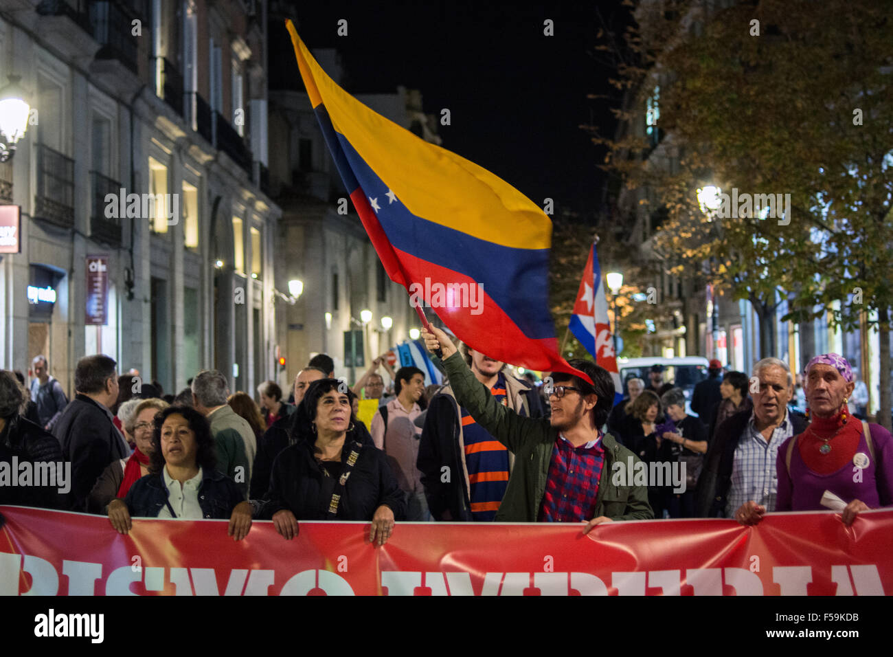 Madrid, Spain. 30th Oct, 2015. People bring banner and flags during a demonstration in Madrid against imperialism - Stock Image
