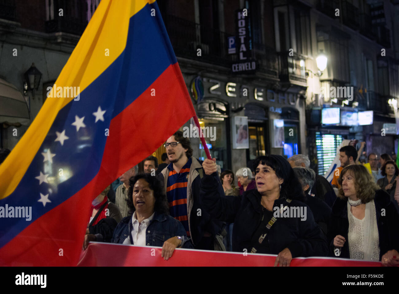 Madrid, Spain. 30th Oct, 2015. A woman waving Venezuelan flag during a demonstration in Madrid against imperialism - Stock Image