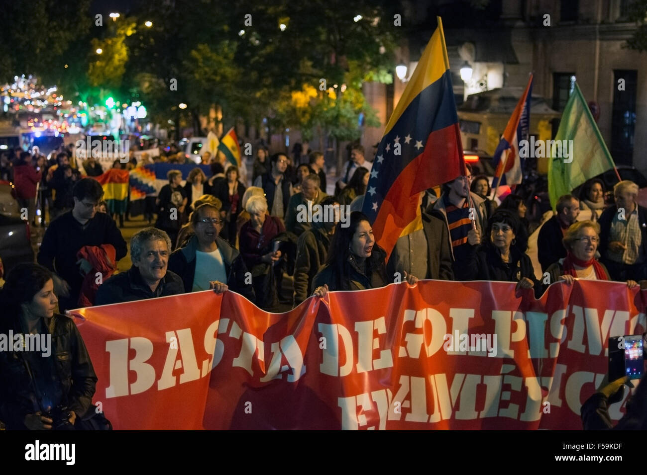Madrid, Spain. 30th Oct, 2015. People hold banner and shout slogans during a demonstration against imperialism in - Stock Image