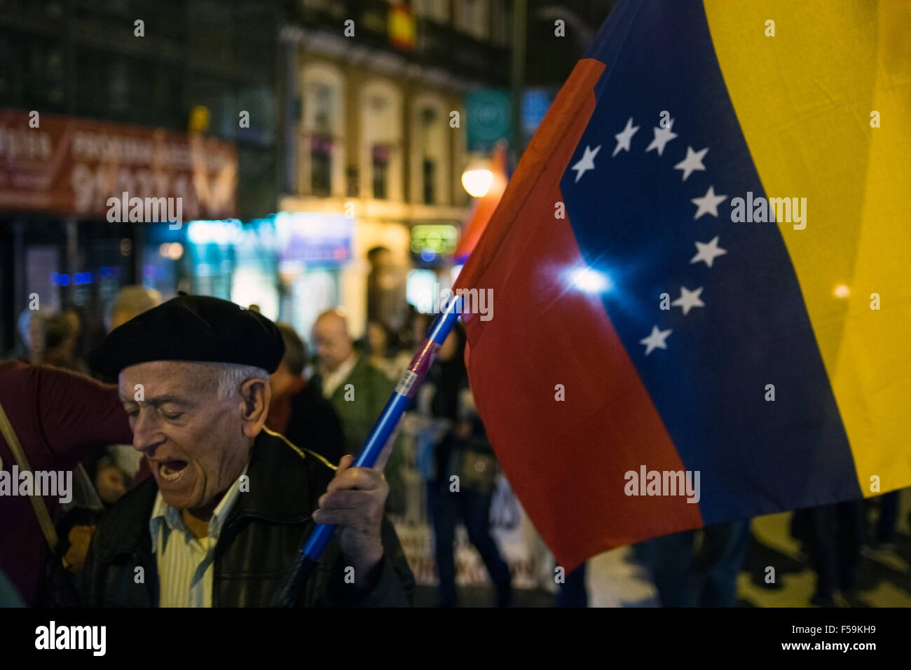 Madrid, Spain. 30th Oct, 2015. A man holds Venezuelan flag during a demonstration in Madrid against imperialism - Stock Image