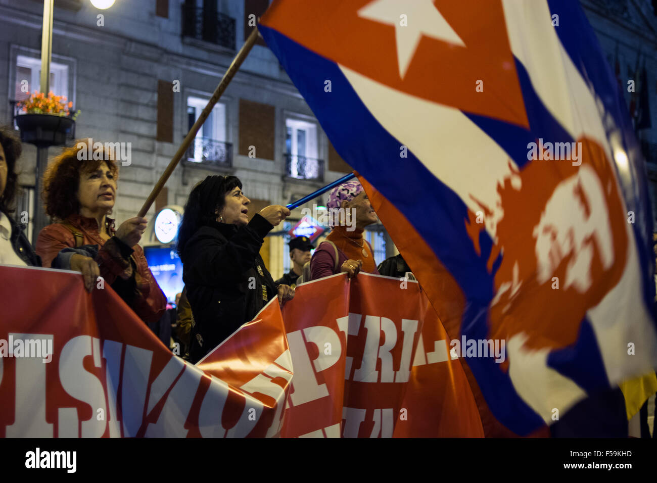 Madrid, Spain. 30th Oct, 2015. People wave flags during a demonstration in Madrid against imperialism in Latin America. - Stock Image
