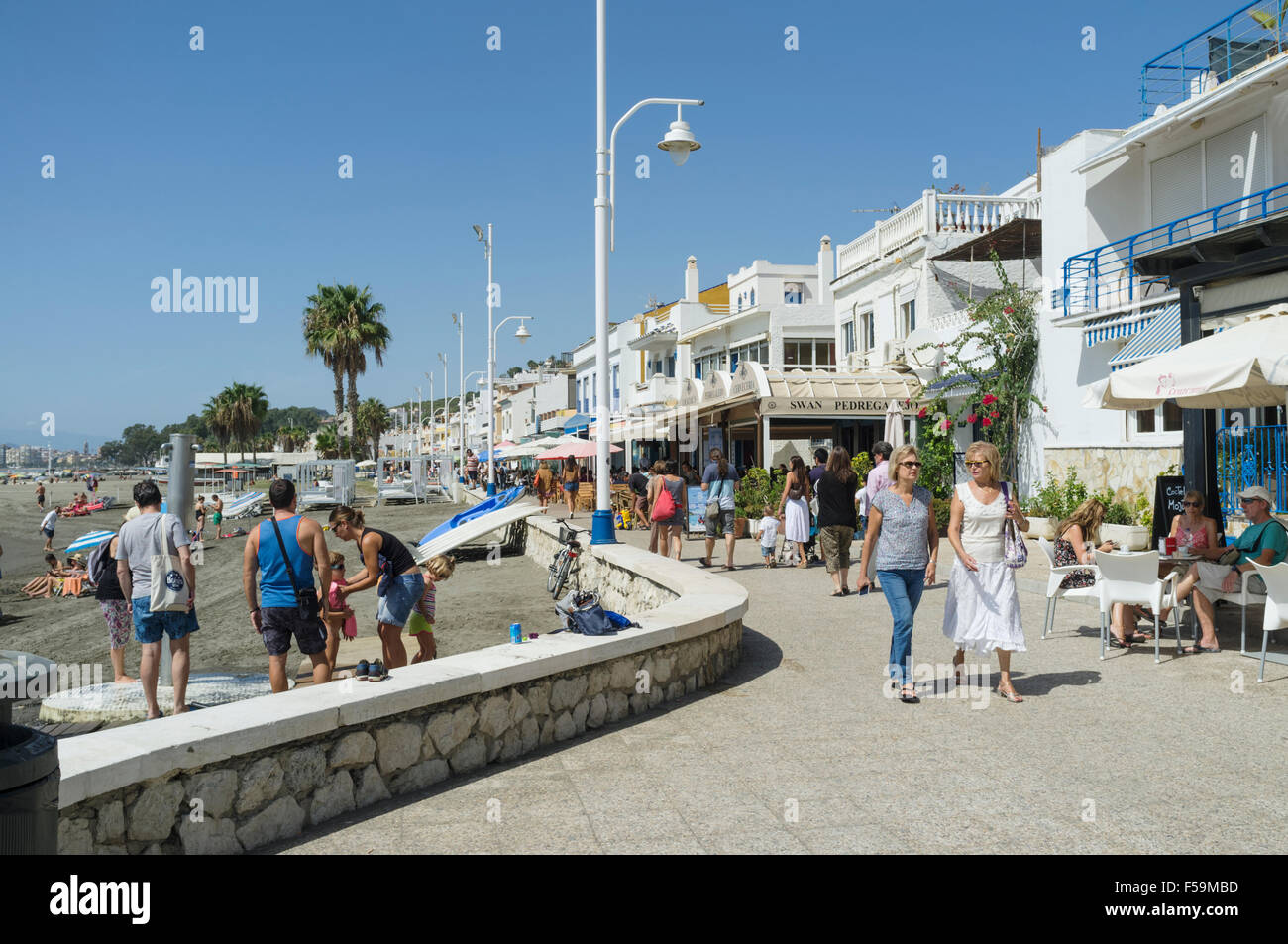 People at the promenade in Pedregalejo, Malaga, Andalusia, Spain. - Stock Image