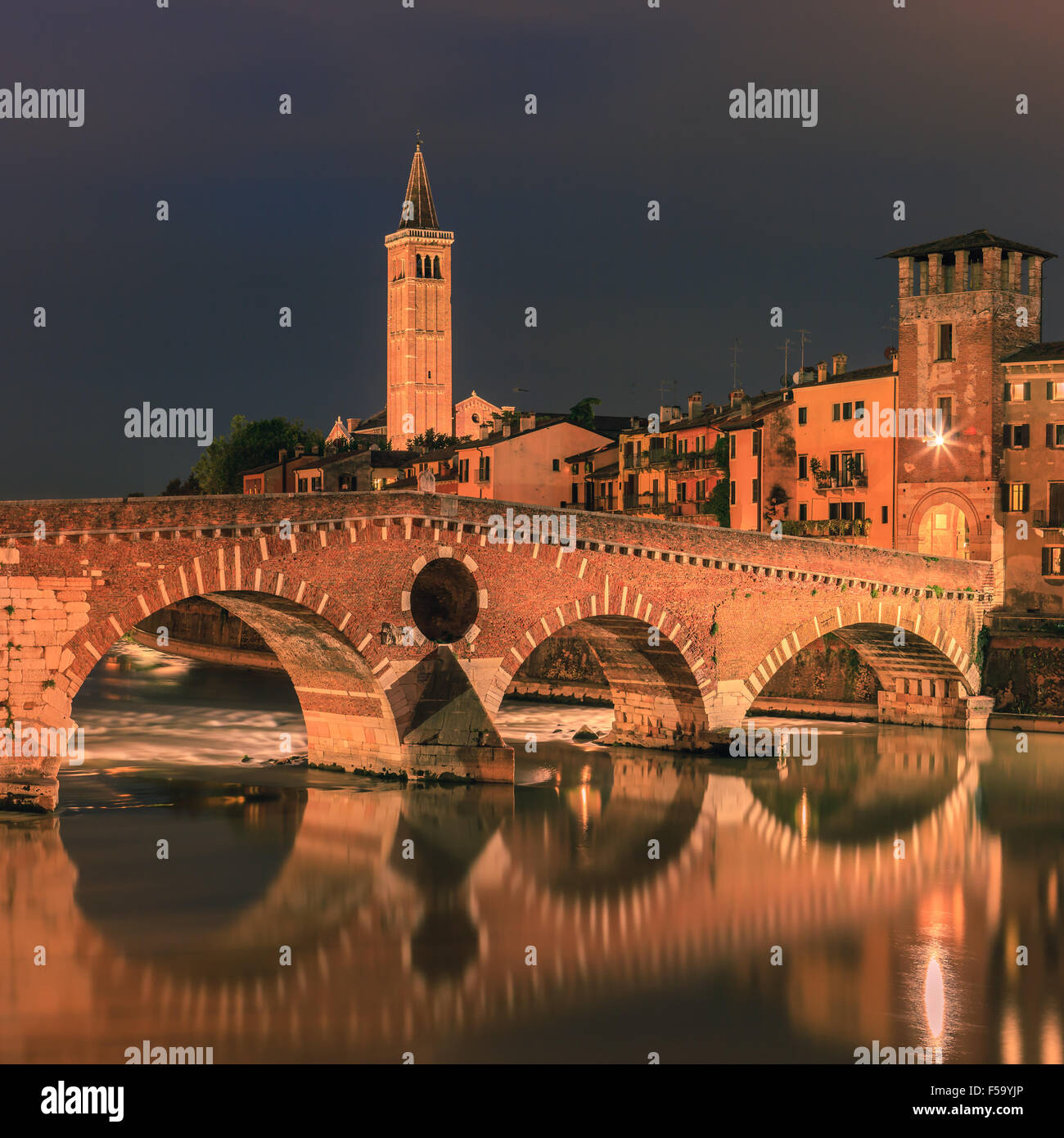 Ponte Pietra bridge at dusk over the Adige river in Verona, Italy - Stock Image