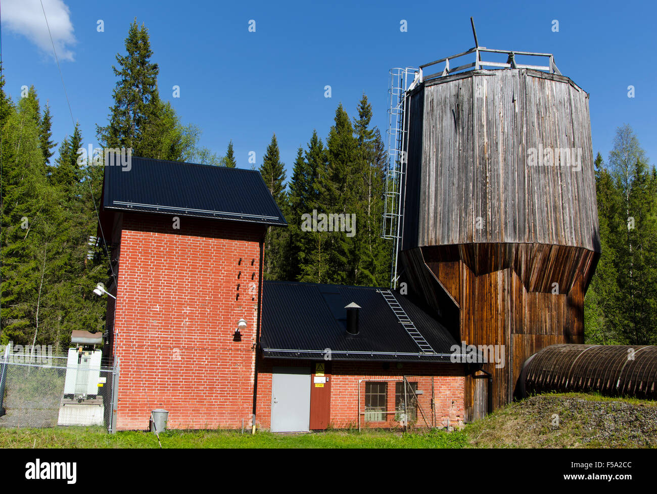 Old electrical powerplant with wooden tube for water, picture from North of Sweden. - Stock Image