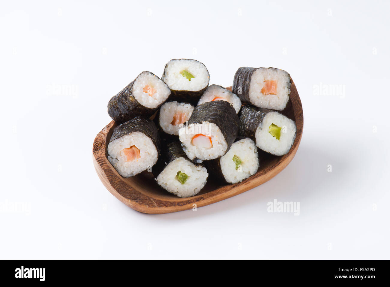 Maki sushi rolls with salmon, crab and cucumber inside - Stock Image