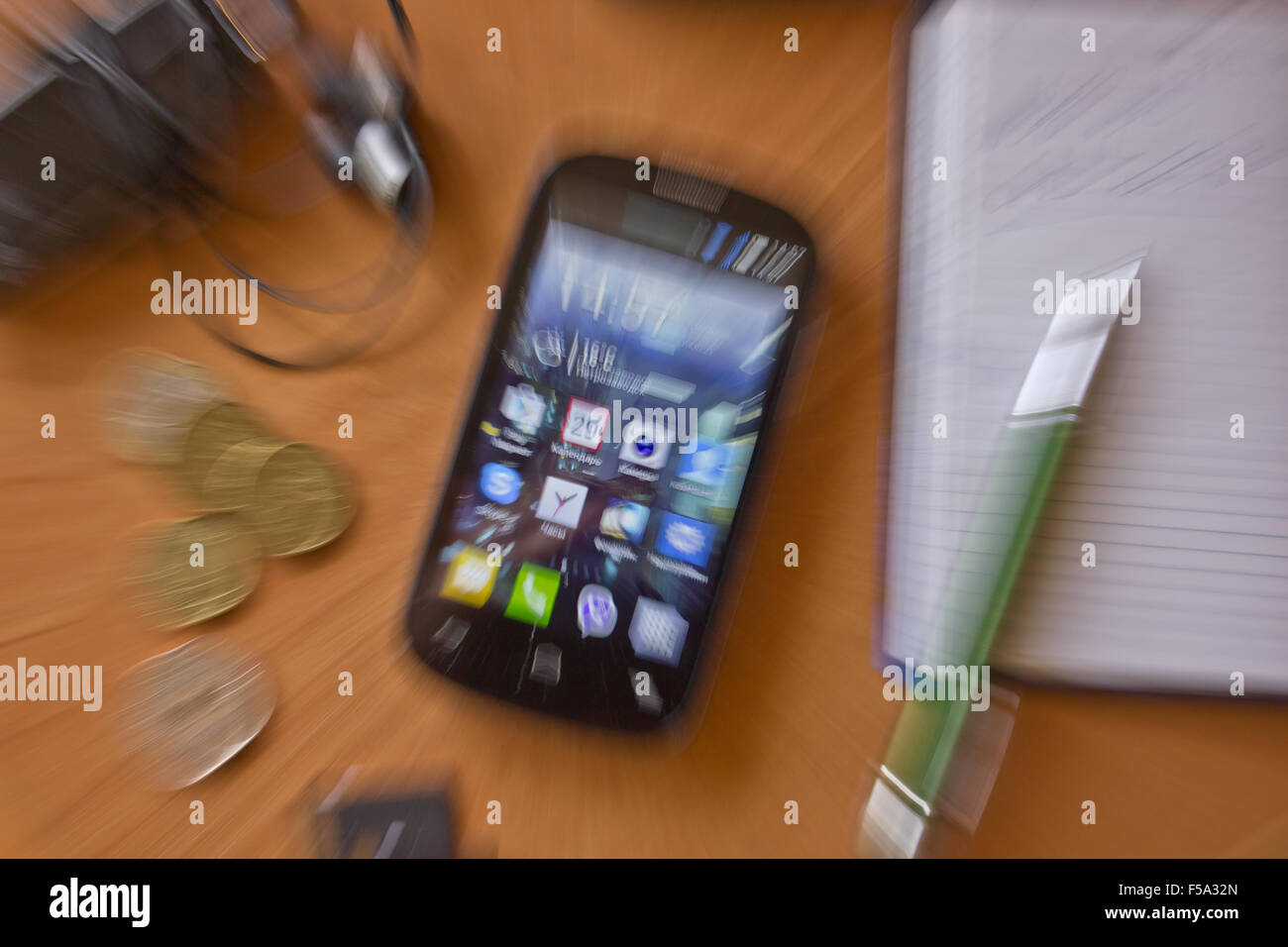 Motion blur around a smartphone - Stock Image