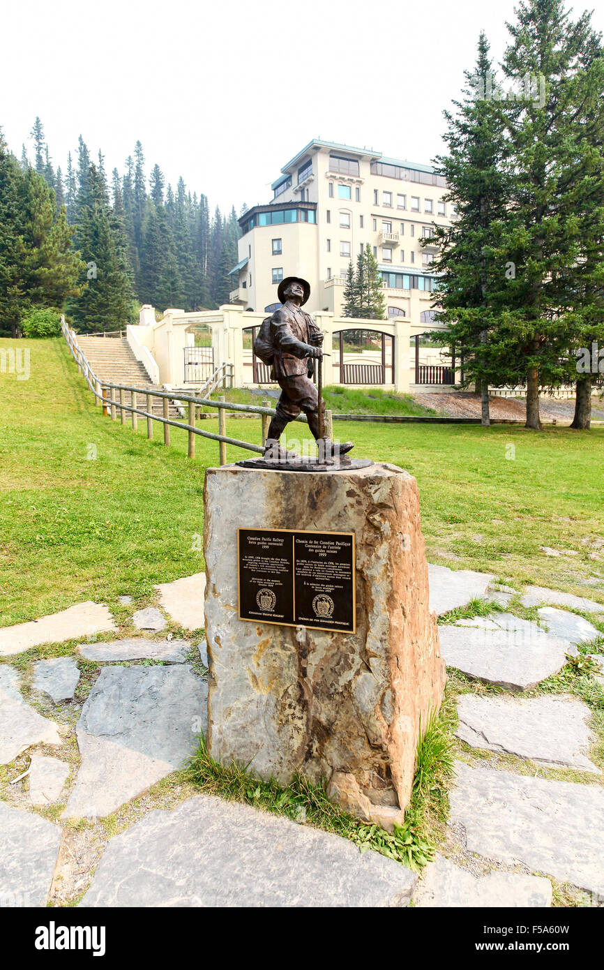 A monument to the Swiss Mountain Guides by the Canadian Pacific Railway Lake Louise Banff National Park Alberta - Stock Image