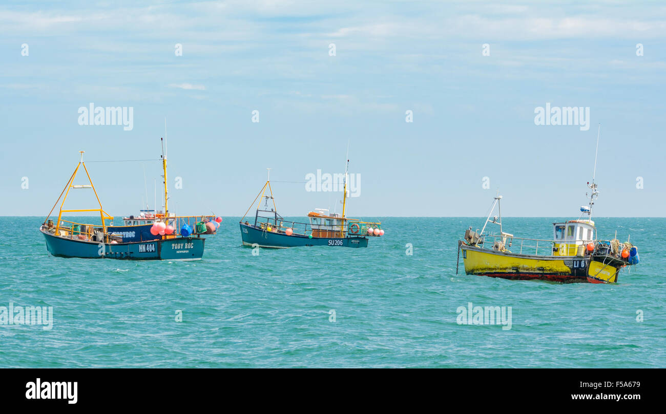 Fishing boats anchored at sea in Selsey, West Sussex, England, UK. - Stock Image