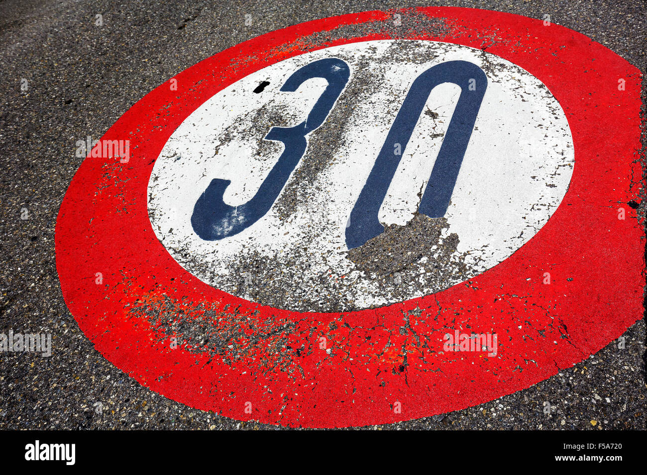 Road sign speed limit of thirty per hour Stock Photo