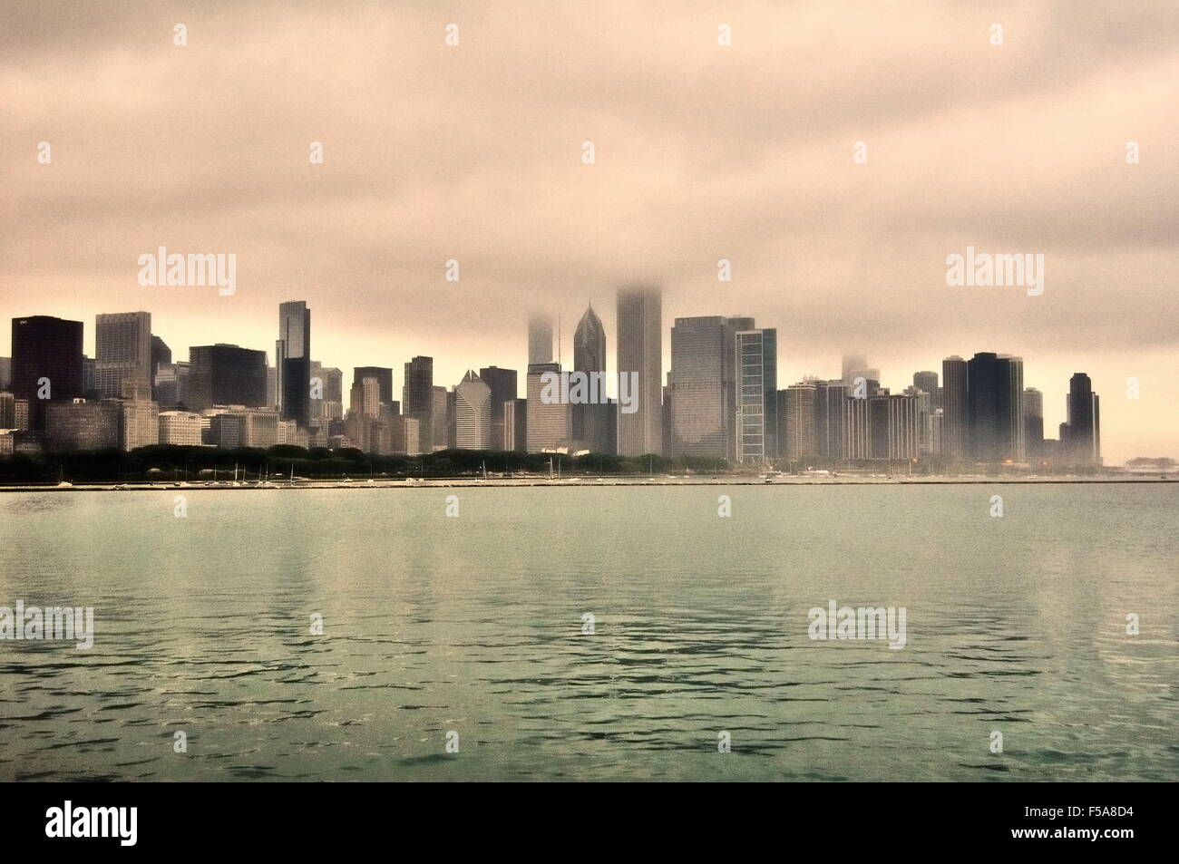 Portions of the Chicago skyline are obscured by low ceiling clouds and fog on a spring morning. Chicago, Illinois, - Stock Image