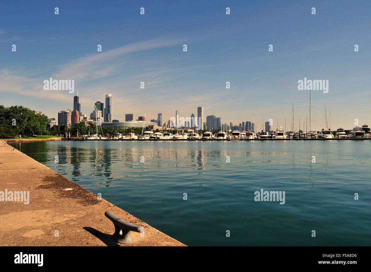 The water of Lake Michigan in Burnham Harbor provides a foreground for  a portion of the city skyline. Chicago, - Stock Image