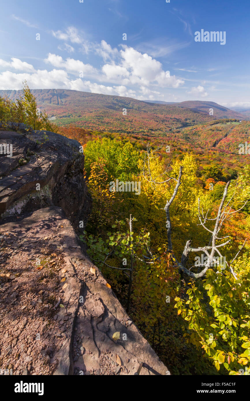 Peak Autumn Colors on Belleayre Mountain and valleys below seen from a ledge on Monka Hill in the Catskills Mountain - Stock Image