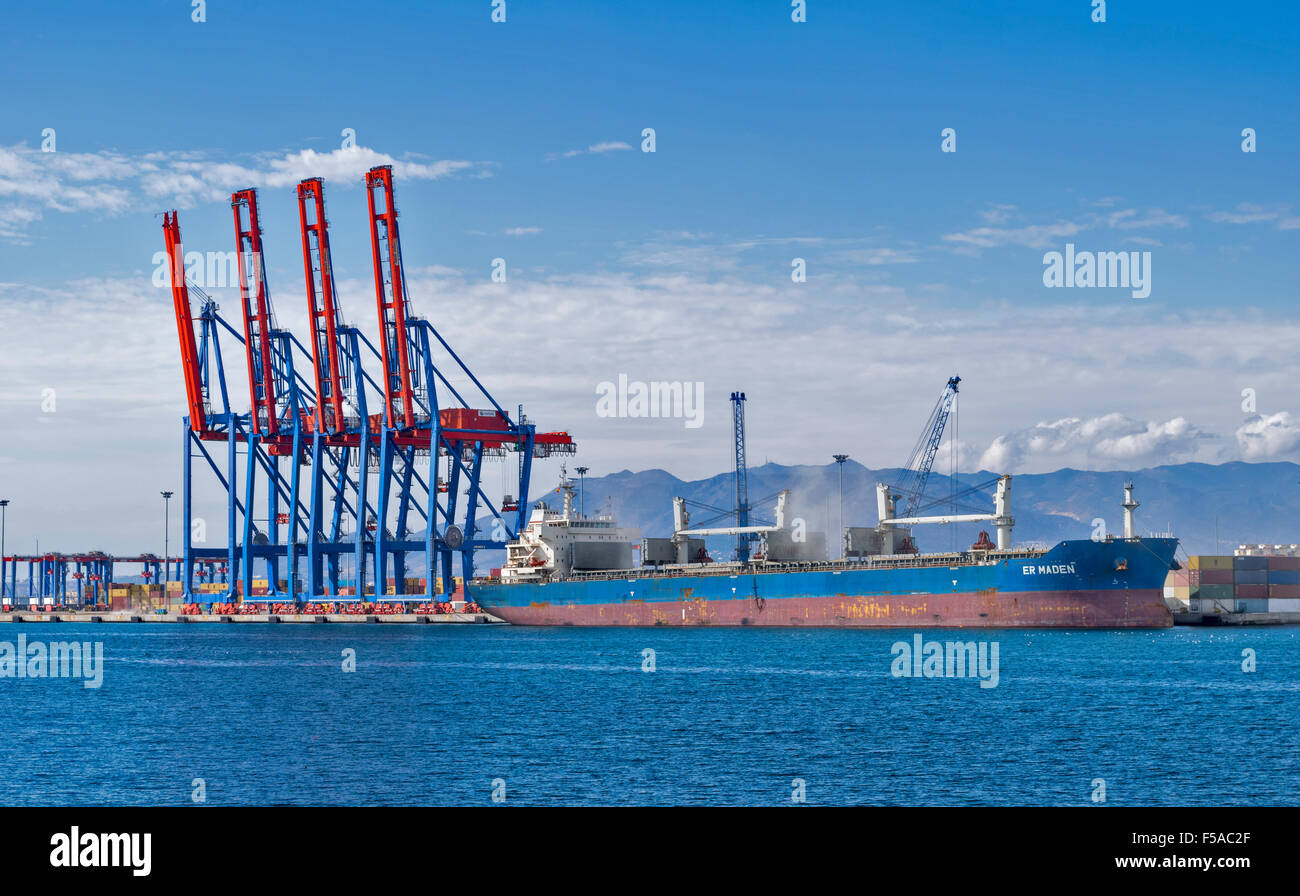 MALAGA ANDALUCIA SPAIN THE HARBOUR WITH SHIP UNLOADING A DUSTY CARGO - Stock Image