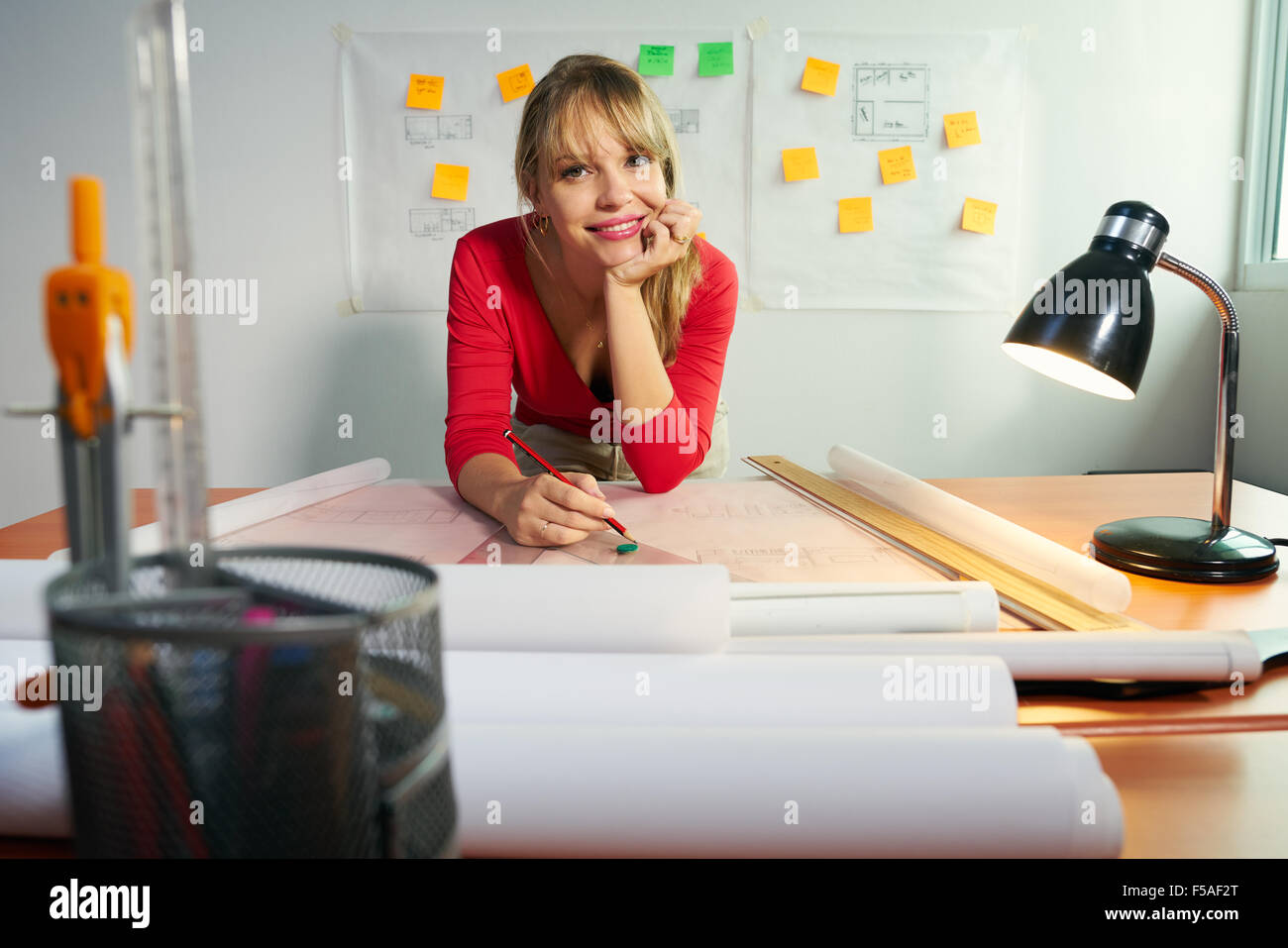 University student of Interior Design doing homeworks, reviewing housing project and completing project. The girl Stock Photo