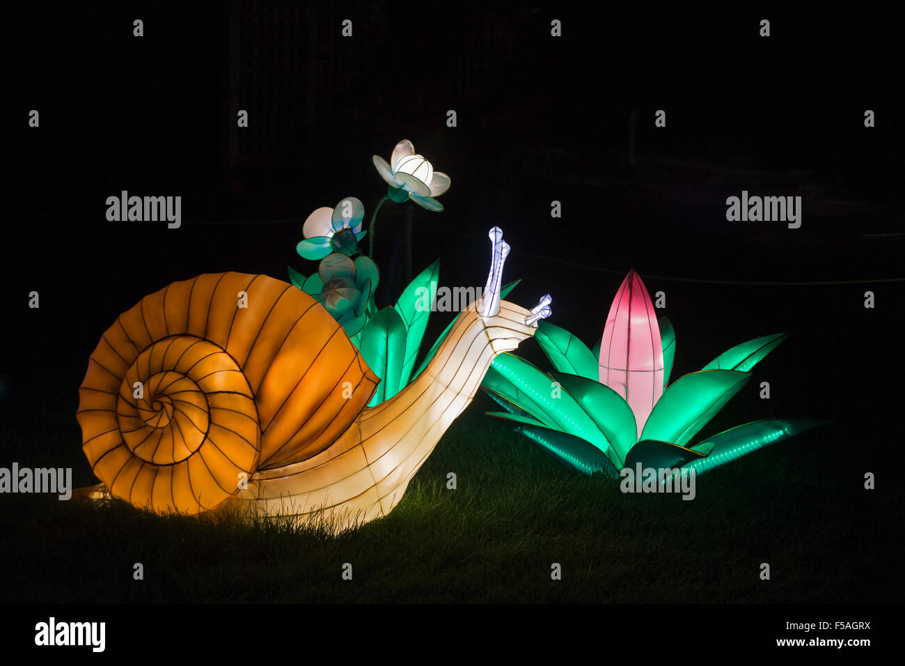 Snail lantern at the Illuminasia Lantern Festival, handmade by Chinese artisans,  powered by energy efficient LED - Stock Image