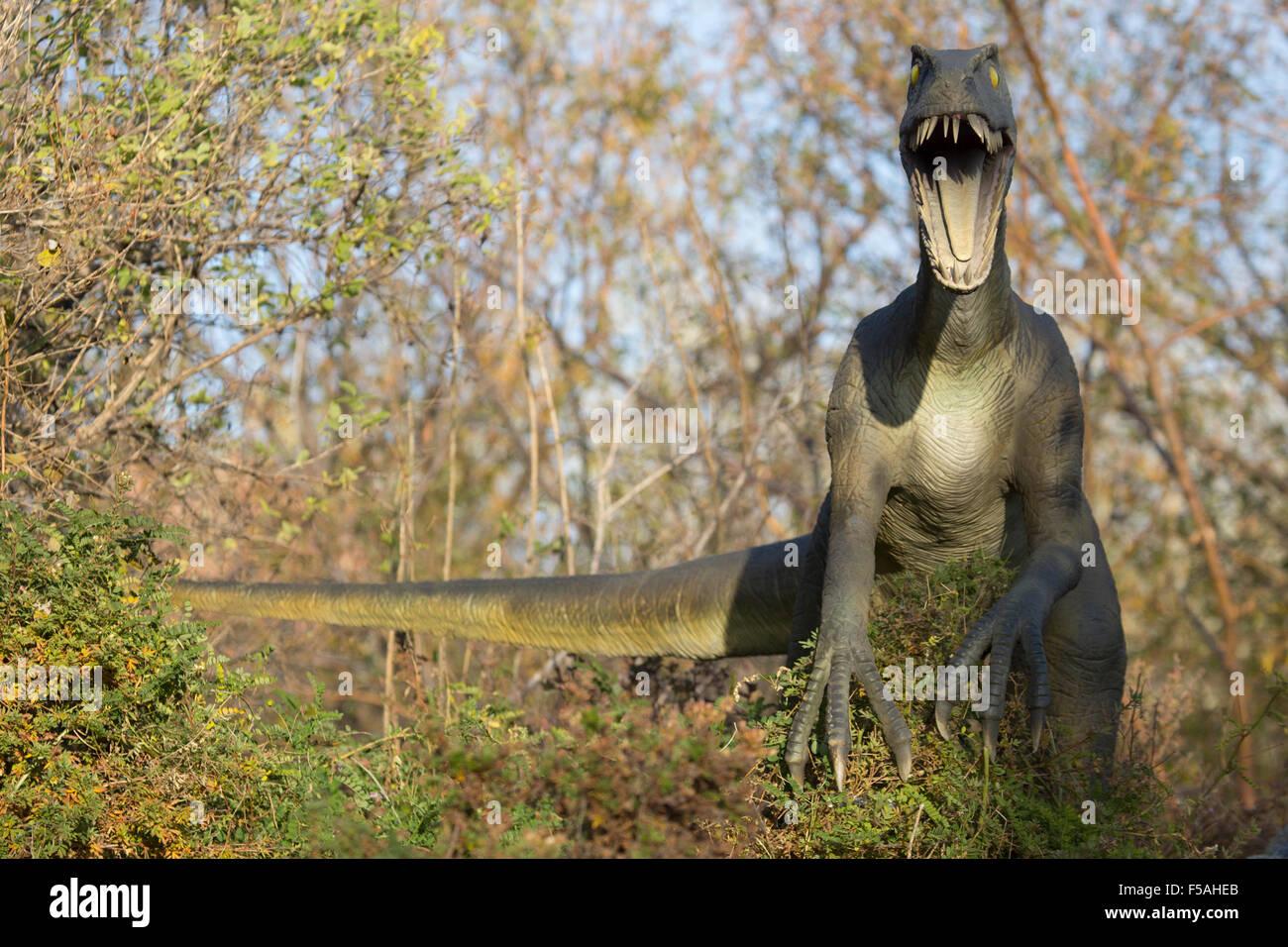 Animated velociraptor model at the Calgary Zoo prehistoric park - Stock Image